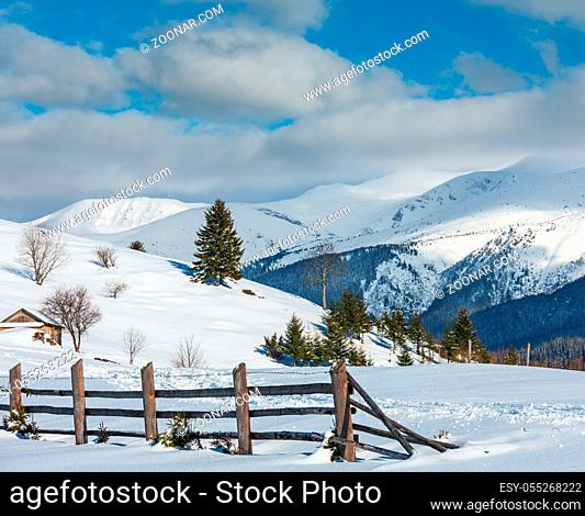 Winter morning scenery picturesque mountain rural snow covered path and footprint on hill top (Ukraine, Carpathian Mountains