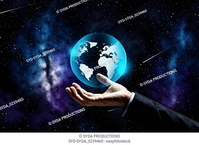 close up of businessman hand with earth projection