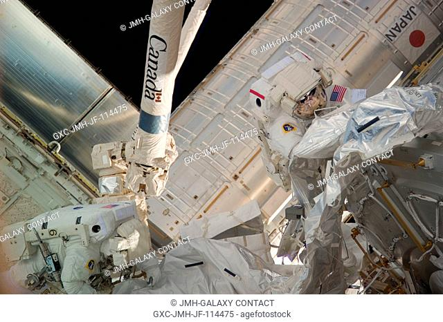 NASA astronauts Robert Behnken (right) and Nicholas Patrick, both STS-130 mission specialists, participate in the mission's second session of extravehicular...