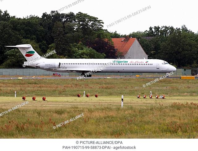 13 July 2019, Berlin: An aircraft of the airline Bulgarian Air Charter is waiting at Tegel Airport for take-off clearance. Photo: Soeren Stache/dpa