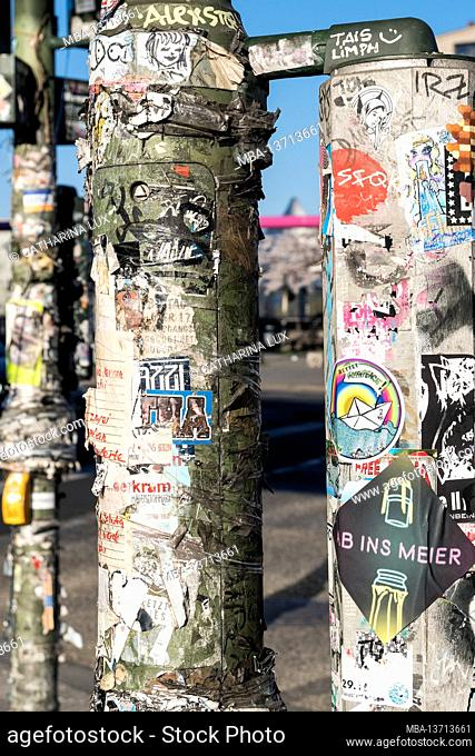 Berlin, banks of the Spree at the Oberbaumbrücke, masts with stickers, scene