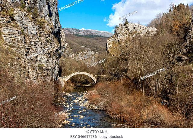 Amazing landscape of Bridge of Kontodimos or Lazaridis in Vikos gorge and Pindus Mountains, Zagori, Epirus, Greece