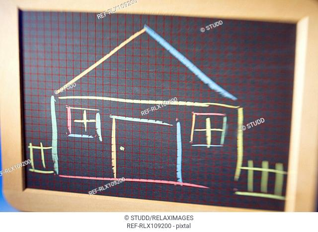 Close up view of Childs chalk board showing coloured drawing of house