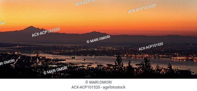 Sun rises over Vancouver, BC, Canada