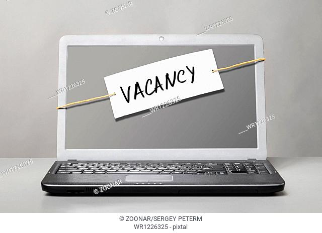 laptop with vacancy note