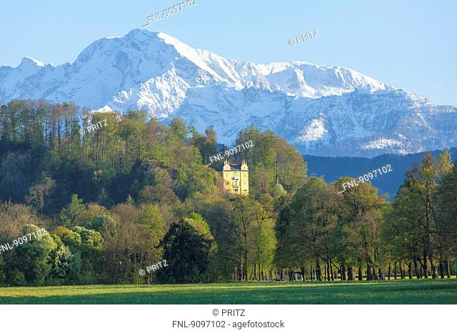 Park of Hellbrunn Castle with Monatsschloessl and Alps, Salzburg, Austria