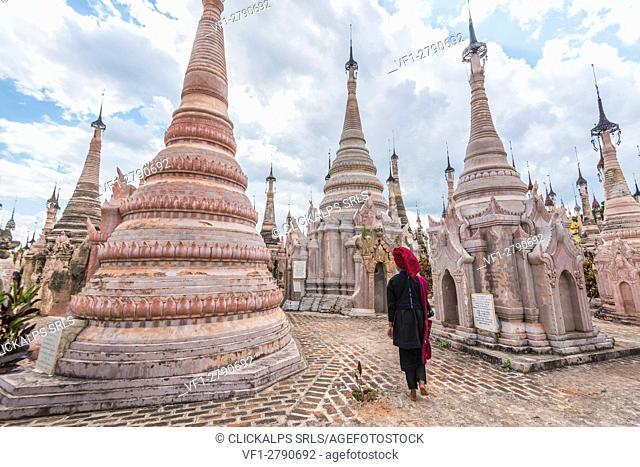 Kakku, Taunggyi, Shan State, Myanmar (Birmania). A woman walking between the 2478 stupas