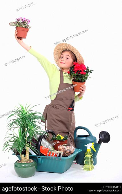 little girl gardening isolated on white
