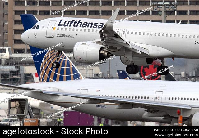 13 March 2020, Hessen, Frankfurt/Main: A Lufthansa Airbus A-320 neo lands at Frankfurt Airport. The aviation industry is also affected by the travel...