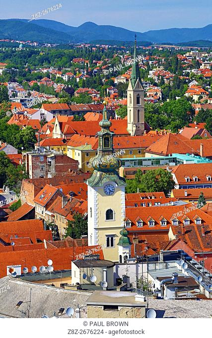 Aerial view of rooftops and the towers of St Mary's Church and St Francis Church in Zagreb, Croatia