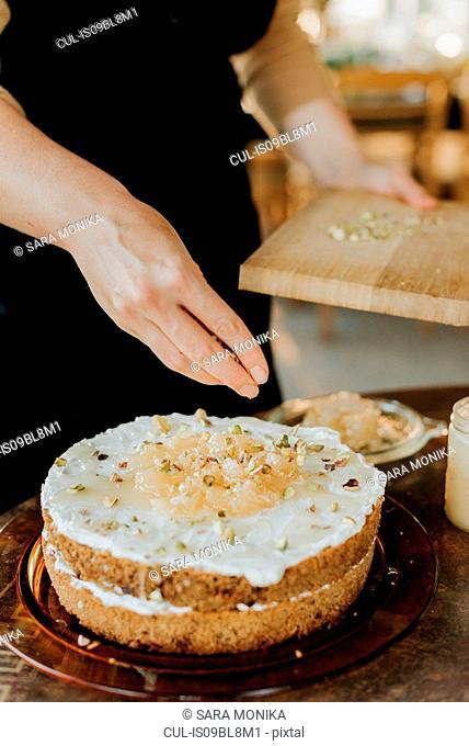 Woman in apron baking vegetarian cake