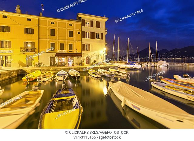 Twilight at the harbour of Castelletto, Brenzone sul Garda, Garda Lake, Verona province, Veneto, Italy, Europe