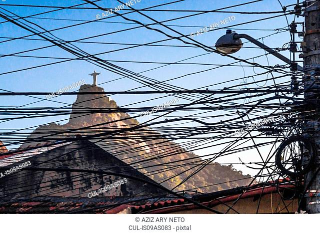 View of Christ the Redeemer statue through telegraph wires and cables, Rio De Janeiro, Brazil