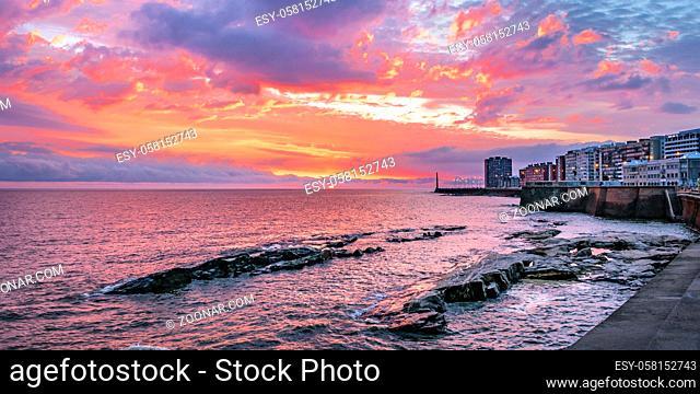 Beautiful urban coastal sunset scene at rambla sur, one of the boardwalks of montevideo city, uruguay