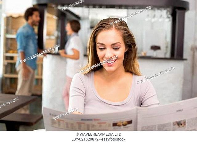 Pretty blonde reading the newspaper