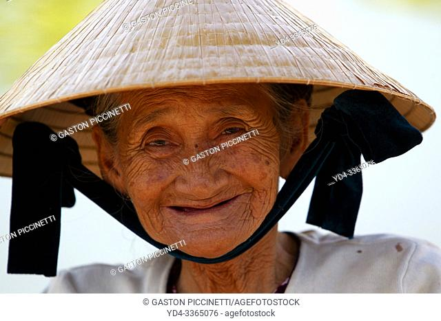 Old woman, Hoi An Ancient Town, Quang Nam Province, Vietnam