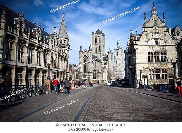 Amazing view from Saint Michael's Bridge with background of belfry Saint Bavo Cathedral. Gent, Belgium