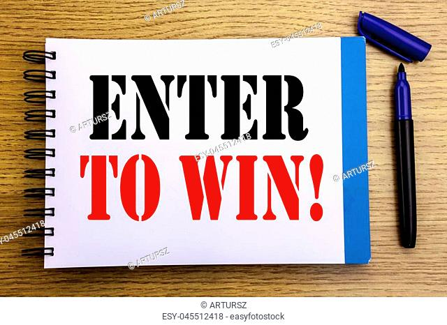 Handwriting Announcement text showing Enter to Win. Business concept for Winning in Competition Written on notepad paper background with space office view with...