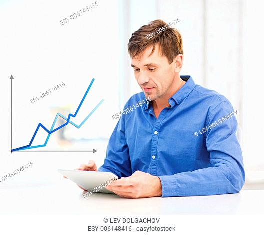 technology, economy and lifestyle concept - handsome man working with tablet pc at home