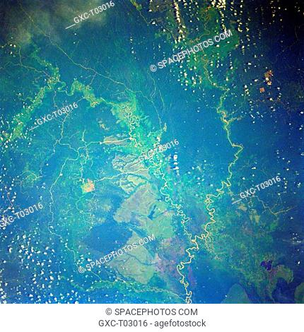 Located near the central east coast of East Kalimantan, this once totally tropical rainforest landscape darker areas now exhibits the impact of recent human...