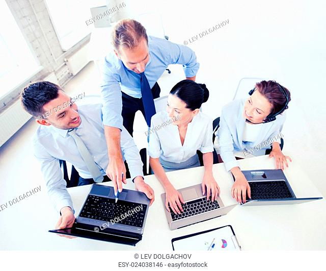 business concept - group of people working in call center or office