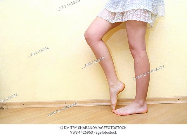 Caucasian female bare legs indoors