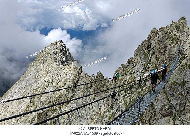 Italy, Retiche Alps, Lagoscuro Mountain Chain, Rope Bridge the Via Ferrata Sentiero dei Fiori