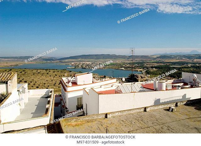 View of rooftops with reservoir and Sierra de Cadiz in background, Arcos de la Frontera. Cadiz province, Andalucia, Spain