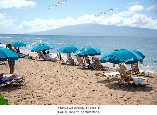 Beach umbrellas along Kaanapali Beach in Lahaina, Maui, Hawaii on Thursday, March 2, 2017. Kaanapali Beach is the home of several hotels and time shares along...