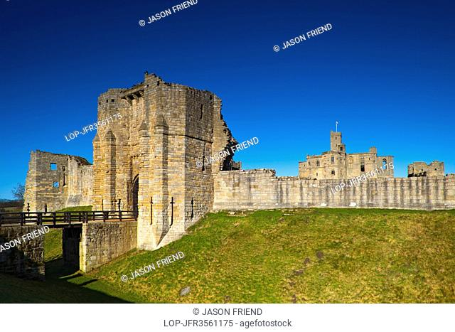 England, Northumberland, Warkworth. Warkworth Castle, a 12th century stone motte and bailey fortress located on a defensive mound in the village of Warkworth