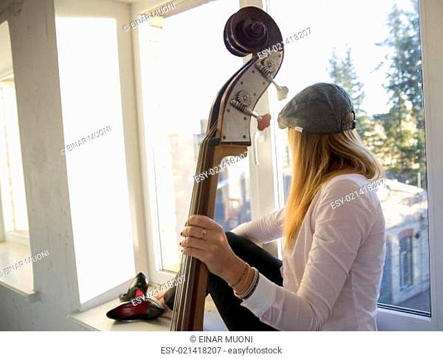 Woman on windowsill and fine weather