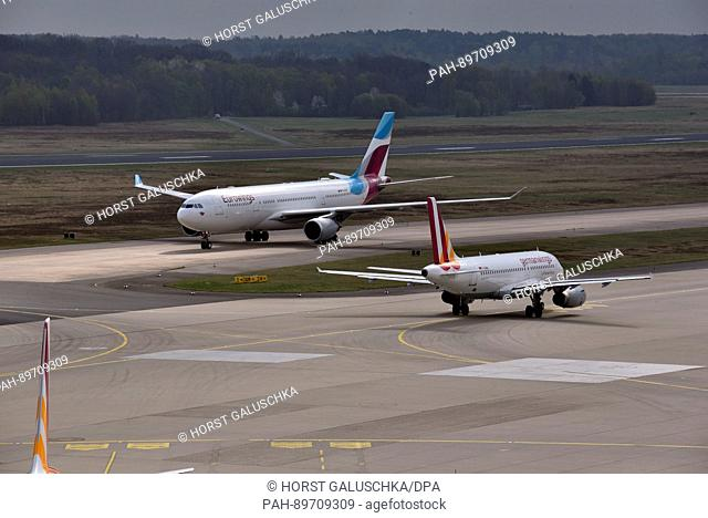 A Germanwings Airbus 319 aircraft and a Eurowings Airbus 330 aircraft seen on the runway at the Cologne Bonn airport in Cologne, Germany, 06 April 2017