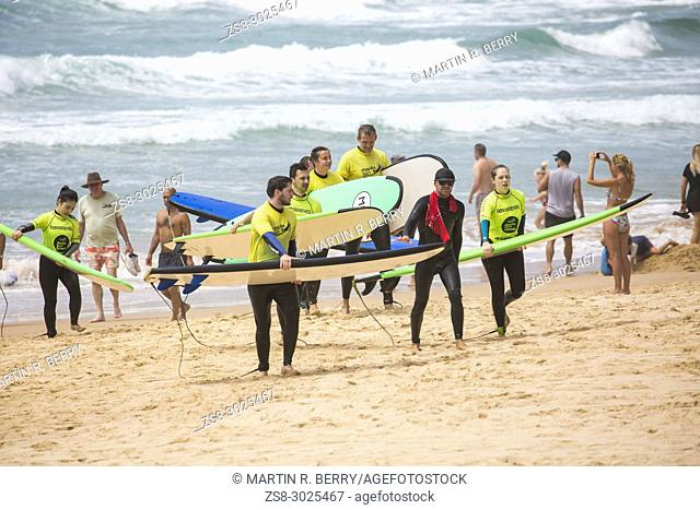 Beginners learning to surf at Manly Beach surf school in Sydney,Australia