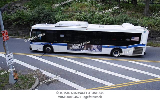 MTA public transportation bus traversing Central Park, New York City