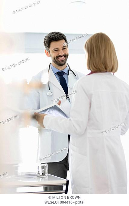 Smiling doctor looking at colleague