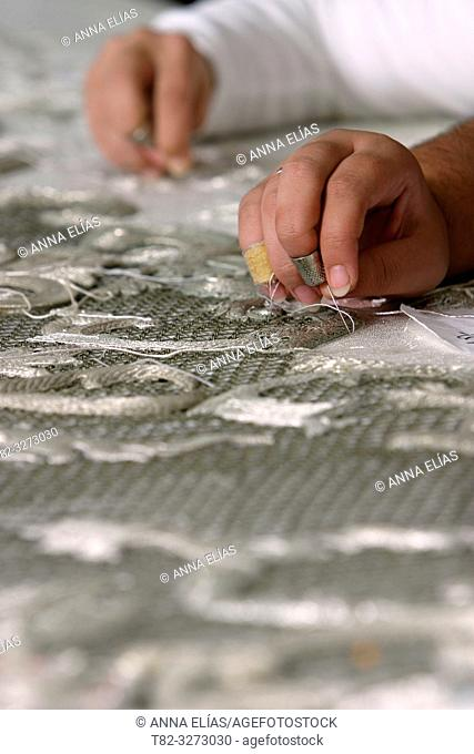 Seamstresses sewing with silver thread, Holy Week, Andalusia, Spain