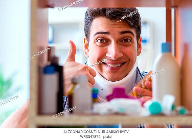 Sick ill man looking for medicines at farmacy shelf