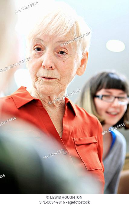 MODEL RELEASED. Woman with dementia with social care worker. Dementia is a general term for conditions that lead to changes in a person's ability to think