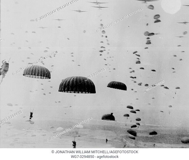 THE NETHERLANDS Arnhem -- Sep 1944 -- Parachutes open overhead as waves of Polish, American and British paratroops land in Holland during the ill-fated...