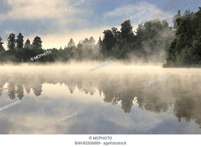 morning mist over the Lake Matheson, New Zealand, Southern Island, Westland National Park