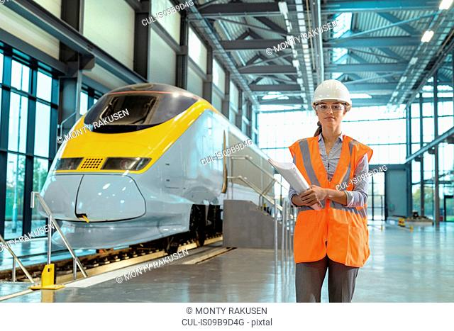 Portrait of female apprentice at railway engineering facility