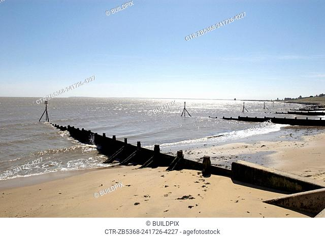 Groynes on sandy beach, Harwich, Essex, UK