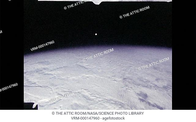View of the Moon setting, seen from orbit aboard Skylab as the space station travels away from it