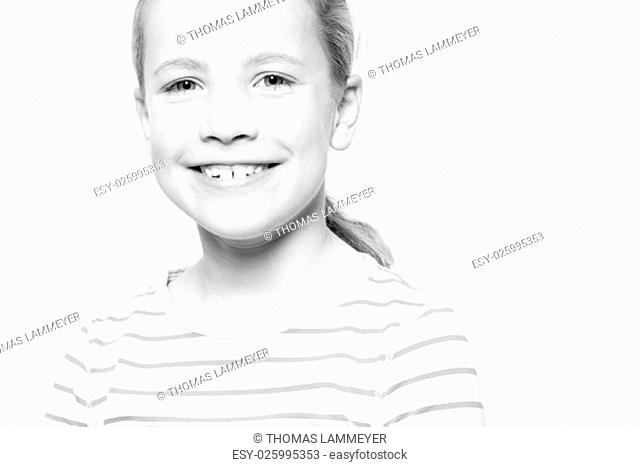 portrait of a child in studio against a white background