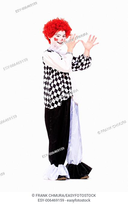 Little Girl in Red Wig, Makeup and Outfit Posing as a Clown