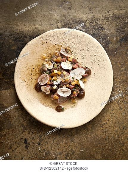 Dry-aged sirloin tartar with oyster sauce and beef drippings