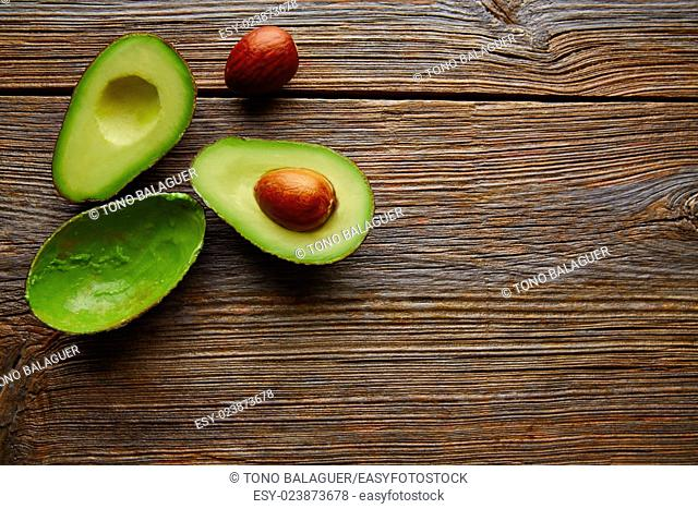 avocado cut on aged wood table board cutted half