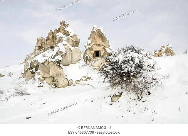 Panorama of unique geological rock formations under snow in Cappadocia where is in the Central Anatolia in Turkey