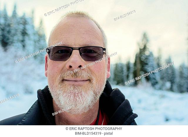 Caucasian man in snowy field