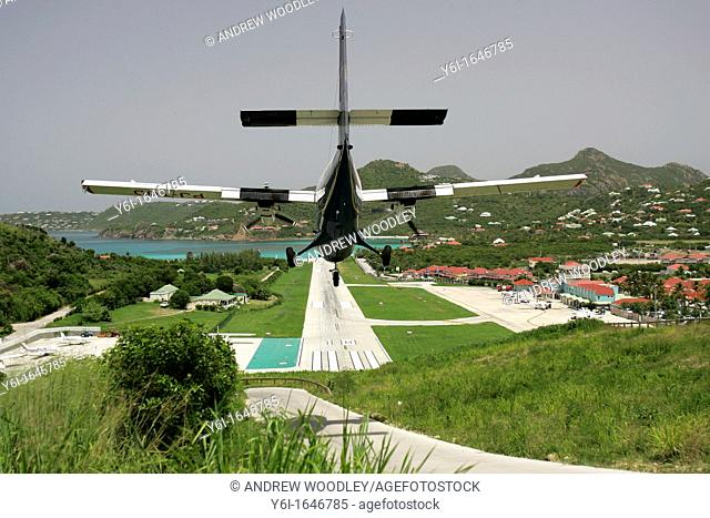 Twin Otter landing on short St Barts airport runway